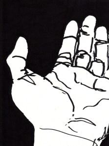 Hand vor schwarzem Hintergrund